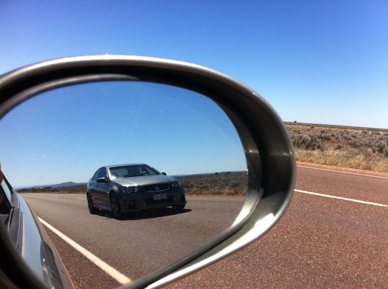 objects in the rear view mirror may appear closer than they really are